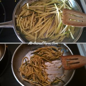 zucchini noodles cooking in pan